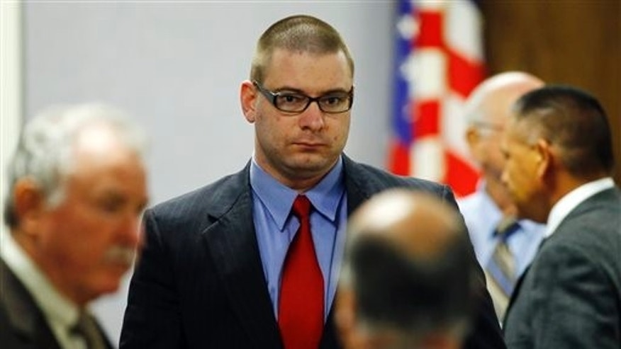 Eddie Ray Routh enters the courtroom following a break in his capital murder trial at the Erath County, Donald R. Jones Justice Center in Stephenville, Texas, Tuesday, Feb. 17, 2015. Routh, of Lancaster, is charged with the 2013 deaths of former Navy SEAL Chris Kyle and his friend Chad Littlefield at a shooting range near Glen Rose, Texas. (AP Photo/Mike Stone, Pool)