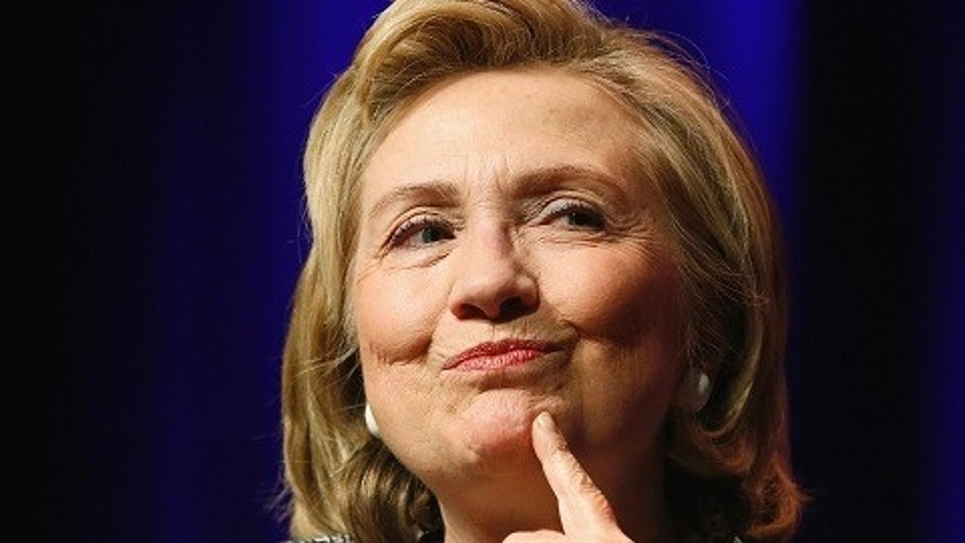 """Former U.S. Secretary of State Hillary Clinton reacts to a question as she discusses her new book """"Hard Choices: A Memoir"""" at George Washington University in Washington June 13, 2014.  REUTERS/Jonathan Ernst    (UNITED STATES - Tags: POLITICS SOCIETY) - RTR3TPDL"""