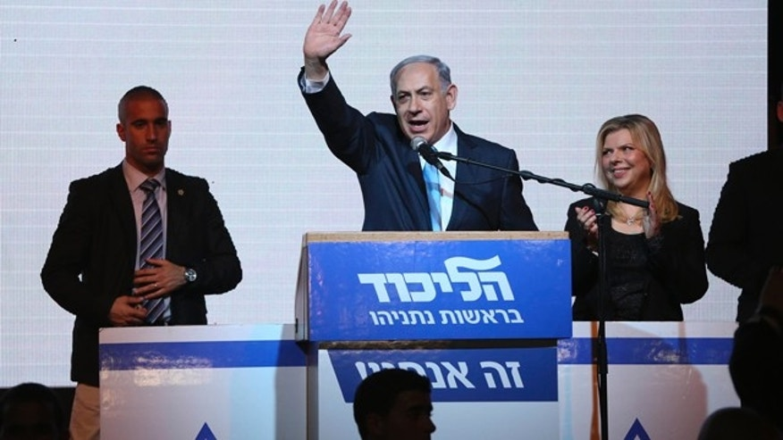 March 17, 2015: Israeli Prime Minister Benjamin Netanyahu greets supporters at the Likud party's election headquarters In Tel Aviv. (AP Photo/Oded Balilty)