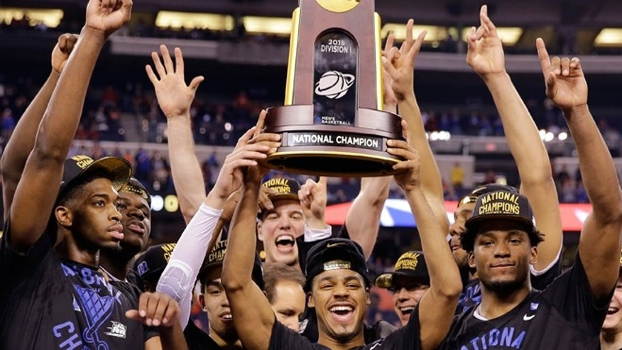 April 6, 2015: Duke players celebrate their 68-63 victory with the championship trophy over Wisconsin in the NCAA Final Four college basketball tournament championship game in Indianapolis.