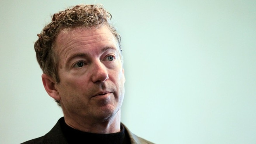 FILE -- March 21, 2015: Sen. Rand Paul, R-Ky., listens to a question at the Epoch Restaurant in Exeter, N.H.