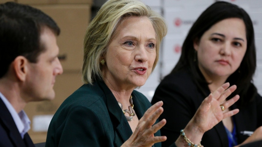 Democratic presidential candidate Hillary Rodham Clinton, center, speaks during a small business roundtable, Wednesday, April 15, 2015, in Des Moines, Iowa.