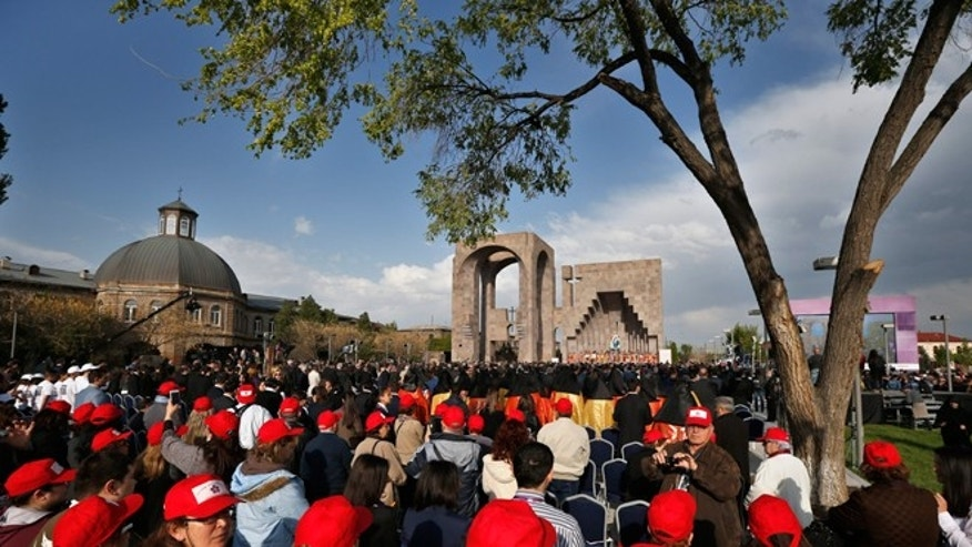 April 23, 2015: Armenians attend a service in Echmiadzin, the religious center of the Armenian Church outside the Armenian capital, Yerevan. The Armenian Apostolic Church, the country's dominant religion, held services Thursday to canonize all victims. On Friday, April 24, Armenians will mark the centenary of what historians estimate to be the slaughter of up to 1.5 million Armenians by Ottoman Turks, an event widely viewed by scholars as genocide. Turkey, however, denies the deaths constituted genocide and says the death toll has been inflated.