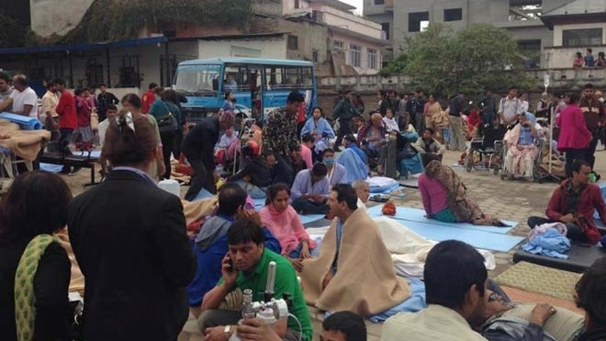 Patients wait at the parking lot of Norvic International Hospital after an earthquake hit Kathmandu, Nepal, Saturday, April 25, 2015. A powerful, magnitude-7.9 earthquake shook Nepal's capital and the densely populated Kathmandu Valley before noon Saturday, collapsing houses, leveling centuries-old temples and cutting open roads in the worst temblor in the Himalayan nation in over 80 years. (AP Photo/Binaj Gurubacharya)