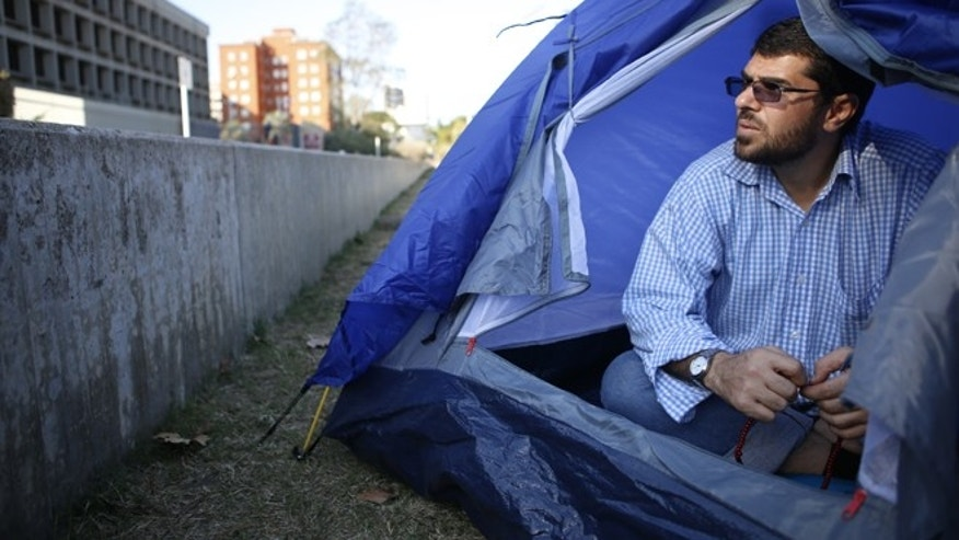 April 28, 2015: Freed Guantanamo Bay detainee Omar Abdelahdi Faraj, from Syria, sits in a tent outside the U.S. embassy as a form of protest in Montevideo, Uruguay.  Uruguay's foreign minister said Monday that six freed Guantanamo Bay detainees who resettled here will be off public assistance unless they agree to terms they have so far rejected, the latest in an increasingly public battle over who is financially responsible for the men and for how long. The men, who are demanding Washington help them financially, spent 12 years at the U.S. military prison but were never charged and were released after officials determined they were no longer a threat.