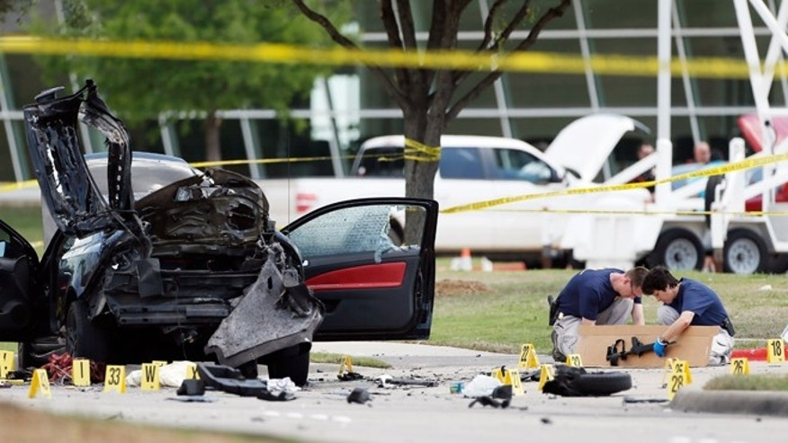 May 4, 2015: Investigators box up an assault weapon outside the Curtis Culwell Center in Garland, Texas. Two men opened fire with assault weapons on police Sunday night who were guarding a provocative contest for Prophet Muhammed cartoons. A police officer returned fire killing both men.