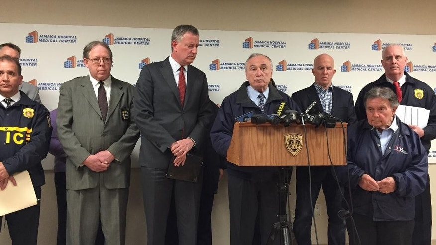Mayor Bill de Blasio and Police Commissioner William Bratton speak at a news conference Saturday night, May 2, 2015, at Jamaica Hospital in Queens, New York,  after a New York City police officer was shot and critically wounded. Detectives were still investigating Sunday after arresting 35-year-old Demitrius Blackwell in the shooting of Officer Brian Moore.  (AP Photo/Mike Balsamo)