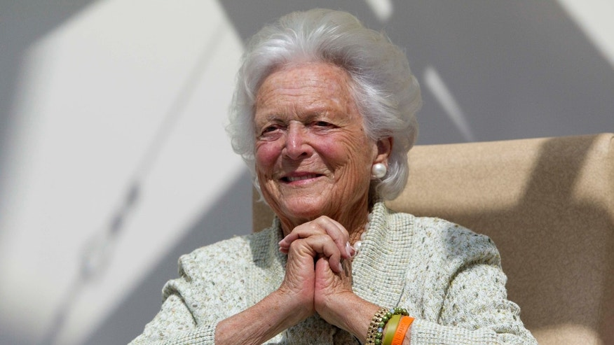 FILE -- Aug. 22, 2013: Former First Lady Barbara Bush listens to a patient's question during a visit to the Barbara Bush Children's Hospital at Maine Medical Center in Portland, Maine.