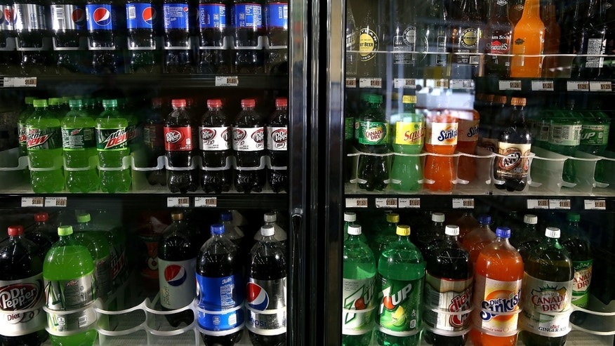 SAN FRANCISCO, CA - JULY 22:  Various bottles of soda are displayed in a cooler at Marina Supermarket on July 22, 2014 in San Francisco, California. The San Francisco Board of Supervisors will vote on Tuesday to place a measure on the November ballot for a 2-cents-per-ounce soda tax. If the measure passes in the November election, tax proceeds would help finance nutrition, health, disease prevention and recreation programs.  (Photo by Justin Sullivan/Getty Images)
