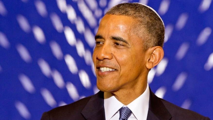 May 22, 2015: President Obama smiles as he speaks at Adas Israel Congregation in Washington, Friday , as part of Jewish American Heritage Month. The president addressed one of the largest Jewish congregations in Washington to highlight efforts to combat anti-Semitism, a problem he says has created an intimidating environment worldwide for Jewish families. The appearance coincides with Solidarity Shabbat, devoted to showing unity by political leaders in Europe and North America against anti-Semitism. (AP Photo/Jacquelyn Martin)