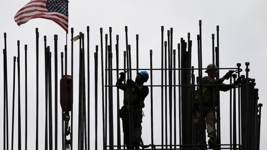 FILE -- April 27, 2015: rodbusters install rebar on the new Comcast Innovation and Technology Center under construction, in Philadelphia. The Commerce Department released first-quarter gross domestic product on May 29, 2015. (AP Photo/Matt Rourke, File)
