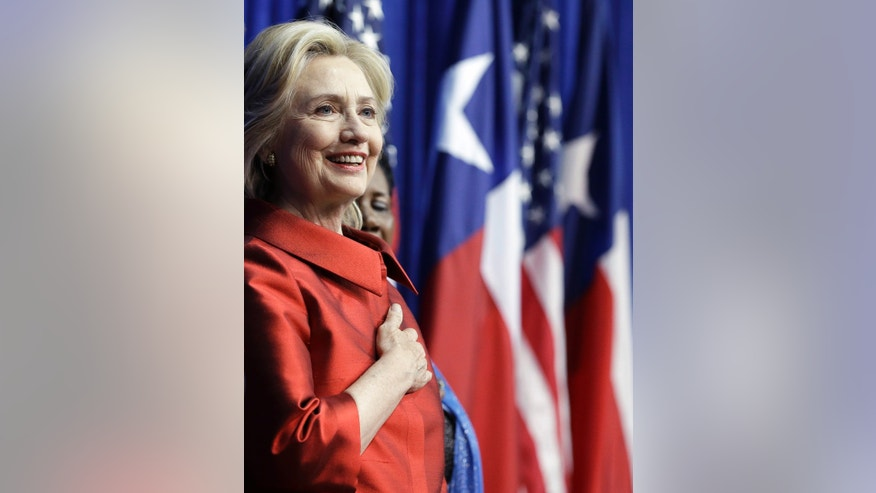 FILE -- June 4, 2015: Democratic presidential candidate Hillary Rodham Clinton listens to the National Anthem before speaking at Texas Southern University in Houston. (AP Photo/Pat Sullivan)