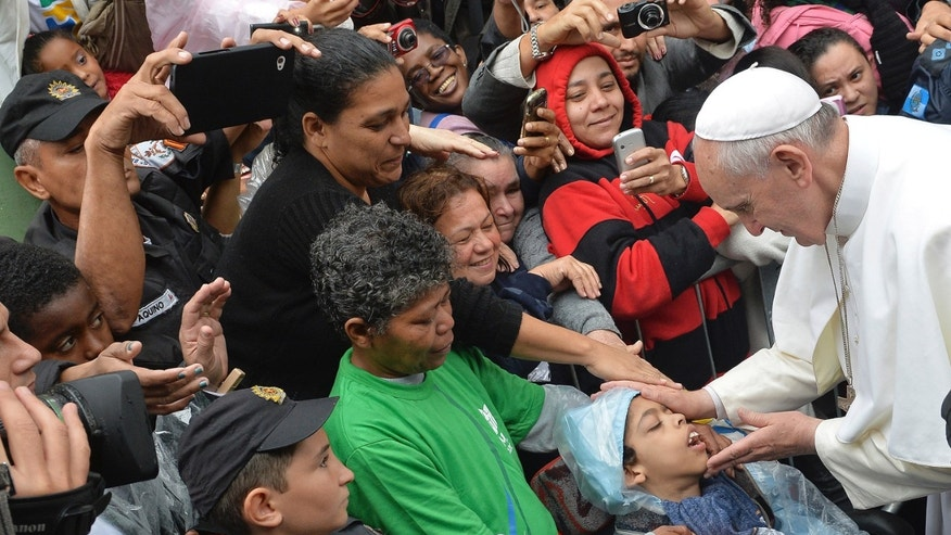 Pope Francis during his visit to the Varginha slum in Rio de Janeiro, Brazil, Thursday, July 25, 2013.