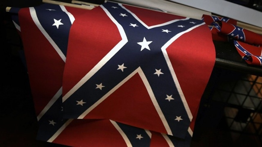 June 23, 2015: Small Confederate flags are displayed on a shelf at Arkansas Flag and Banner in Little Rock, Ark. Major retailers including Amazon, Sears, eBay and Etsy and Wal-Mart Stores Inc., are halting sales of the Confederate flag and related merchandise. (AP Photo/Danny Johnston)