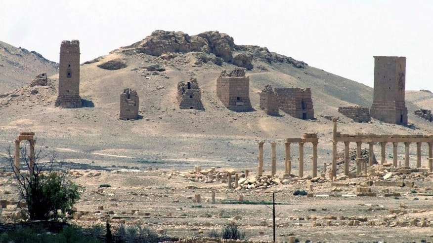 FILE - This file photo released on Sunday, May 17, 2015, by the Syrian official news agency SANA, shows the general view of the ancient Roman city of Palmyra, northeast of Damascus, Syria. A Syrian official said Wednesday, June 24, 2015 that the Islamic State group has destroyed two mausoleums in the historic central town of Palmyra. SANA via AP