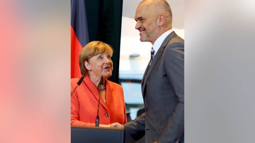 Visiting German Chancellor Angela Merkel and her host Albanian counterpart Edi Rama attend a news conference on the first stop of her Balkan tour in Tirana on Wednesday, July 8, 2015.