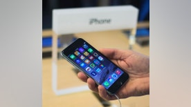 File photo - A customer holds an iPhone 6 on display at the Fifth Avenue Apple store on the first day of sales in Manhattan, New York Sept. 19, 2014.