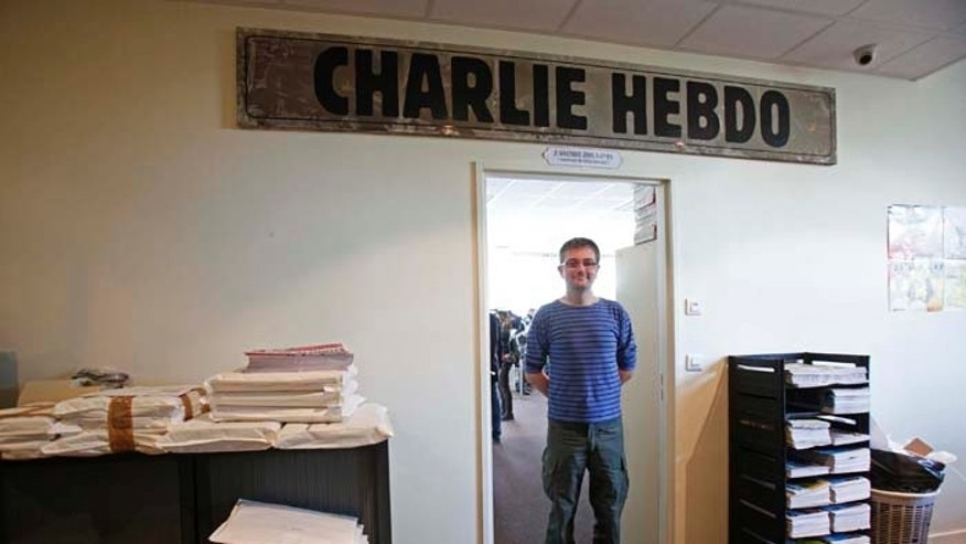 French cartoonist Charb, publishing director of French satirical weekly Charlie Hebdo, poses for photographs at their offices in Paris, September 19, 2012. Charlie Hebdo published cartoons of the Prophet Mohammad on Wednesday, a decision criticised by the French authorities which sent riot police to protect the magazine's offices.   REUTERS/Jacky Naegelen  (FRANCE - Tags: MEDIA CIVIL UNREST POLITICS RELIGION TPX IMAGES OF THE DAY) - RTR3853H