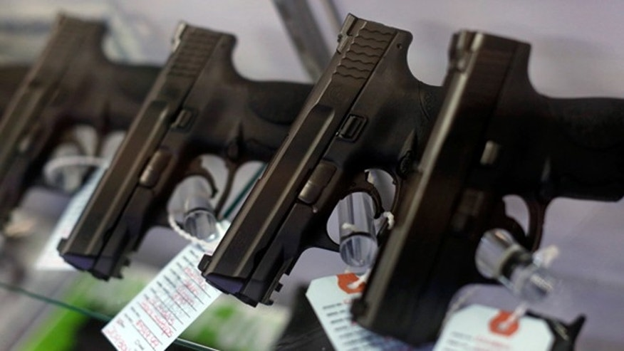 Nov. 13, 2014: Handguns are seen for sale in a display case at a gun store in Bridgeton, Mo.