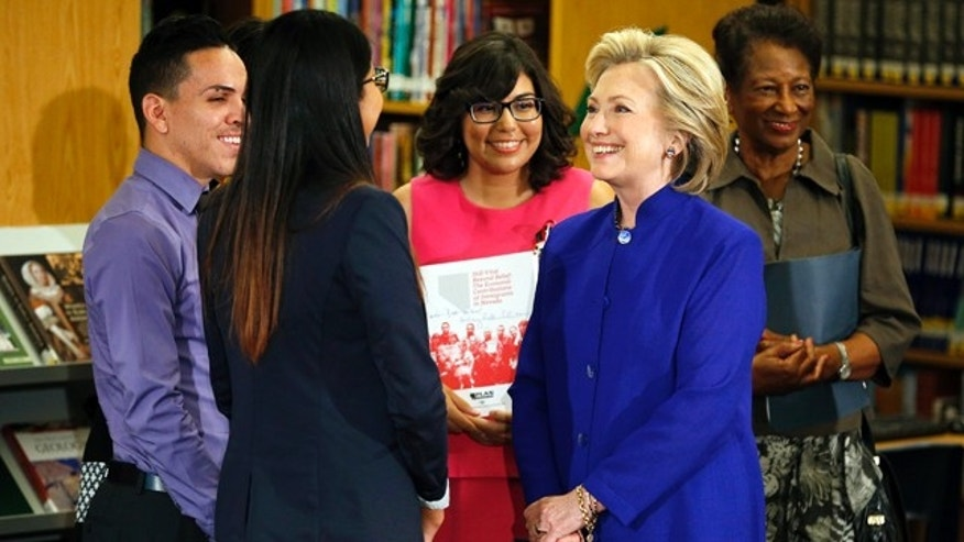 May 5, 2015: Hillary Rodham Clinton, a 2016 Democratic presidential contender, second from right, speaks with a group about immigration at an event at Rancho High School in Las Vegas. (AP Photo/John Locher)