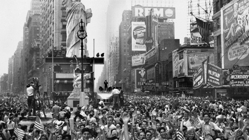 Thousands of people celebrate VJ Day on New York's Times Square August 14, 1945 after Japanese radio report.