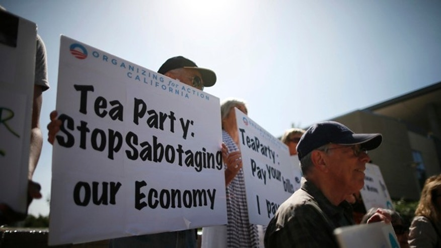 FILE: Oct. 10, 2013: Demonstrators at event on the Affordable Care Act and protest against Tea Party officials, in Santa Monica, Calif.