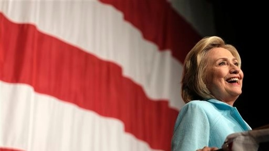 FILE- In this Aug. 14, 2015, photo, Democratic presidential candidate Hillary Rodham Clinton speaks at the at the Iowa Democratic Wing Ding at the Surf Ballroom in Clear Lake, Iowa. (AP Photo/Charlie Riedel, File)