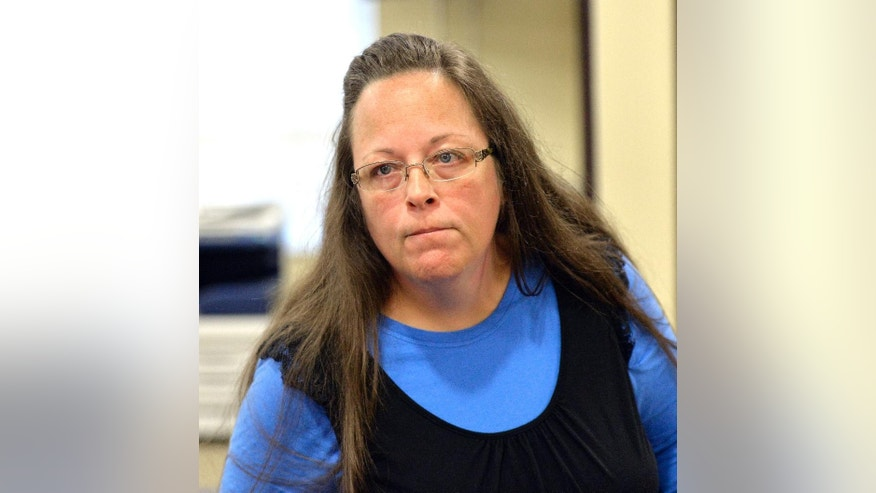 Sept. 1, 2015: Rowan County Clerk Kim Davis listens to a customer following her office's refusal to issue marriage licenses at the Rowan County Courthouse in Morehead, Ky. Although her appeal to the U.S. Supreme Court was denied, Davis still refuses to issue marriage licenses.