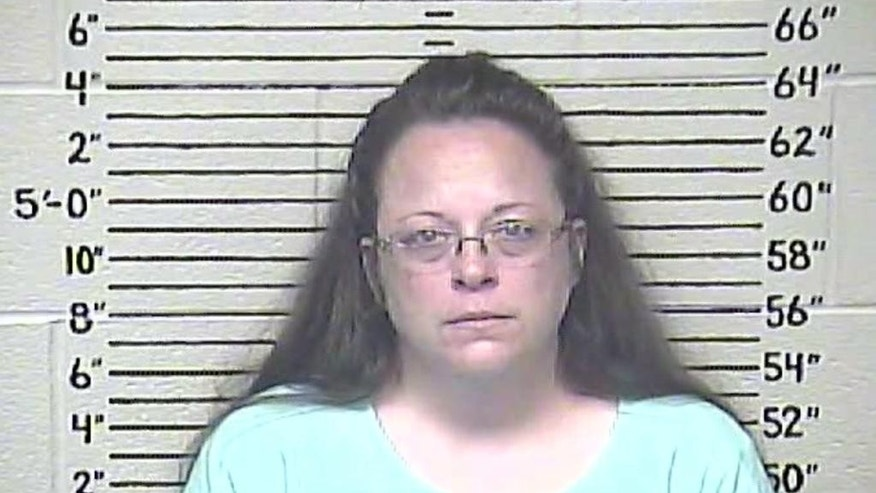 This Thursday, Aug. 3, 2015 photo made available by the Carter County Detention Center shows Kim Davis. The Rowan County, Ky. clerk went to jail Thursday for refusing to issue marriage licenses to gay couples, but five of her deputies agreed to comply with the law, ending a two-month standoff.