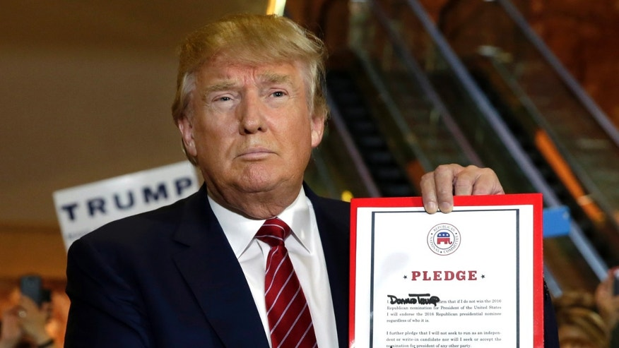 Republican presidential candidate Donald Trump holds his pledge during a news conference, at Trump Tower in New York,  Thursday, Sept. 3, 2015. Trump ruled out the prospect of a third-party White House bid and vowed to support the Republican Party's nominee, whoever it may be. (AP Photo/Richard Drew)