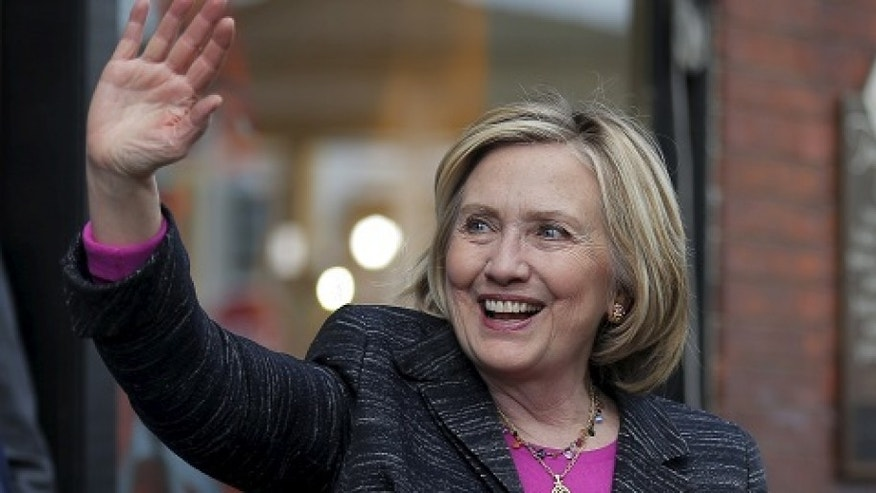 FILE -- May 22, 2015: Democratic presidential candidate Hillary Clinton waves to supporters gathered outside after she spoke at the Water Street Bookstore in Exeter, New Hampshire.