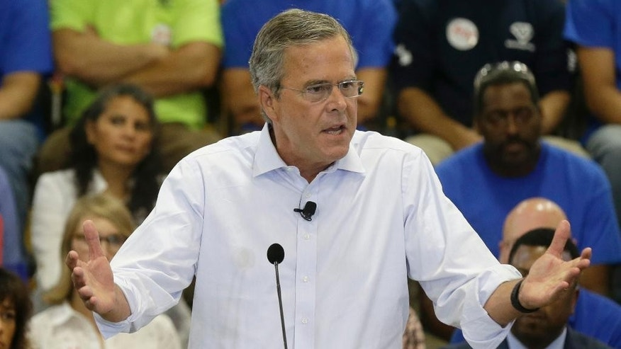 In this photo taken Sept. 9, 2015, Republican presidential candidate, former Florida Gov. Jeb Bush speaks in Garner, N.C. To some Republican presidential candidates, it's better to be with the popular pope than against him.  (AP Photo/Gerry Broome)