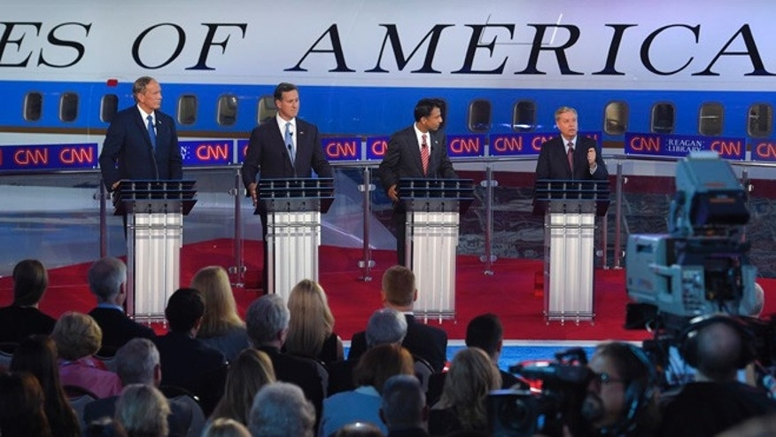 Sept. 16, 2015: Republican presidential candidates, former New York Gov. George Pataki, left, former Pennsylvania Sen. Rick Santorum, second from left, Louisiana Gov. Bobby Jindal, second from right, and Sen. Lindsey Graham, R-S.C., appear during the CNN Republican presidential debate at the Ronald Reagan Presidential Library and Museum on in Simi Valley, Calif.