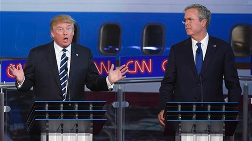 Republican presidential candidate, businessman Donald Trump, left, speaks as Jeb Bush looks on during the CNN Republican presidential debate at the Ronald Reagan Presidential Library and Museum on Wednesday, Sept. 16, 2015, in Simi Valley, Calif. (AP Photo/Mark J. Terrill)