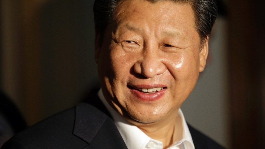 Chinese President Xi Jinping smiles as he concludes a visit to Lincoln High School, Wednesday, Sept. 23, 2015, in Tacoma, Wash. Xi is on the second of a three-day trip to Seattle before traveling to Washington, D.C., for a White House state dinner on Friday. (AP Photo/Elaine Thompson)