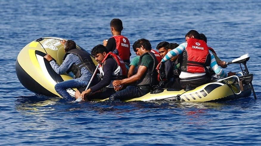Sept. 19, 2015: Migrants in a dinghy with a small motor paddle their craft after leaving Bodrum, Turkey, in the hopes of crossing the Mediterranean Sea to reach the Greek Island of Kos. (Reuters)