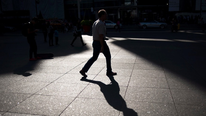 FILE -- Sept. 25, 2015: A person walks through Yonge and Dundas Square in Toronto. (Marta Iwanek/The Canadian Press via AP)