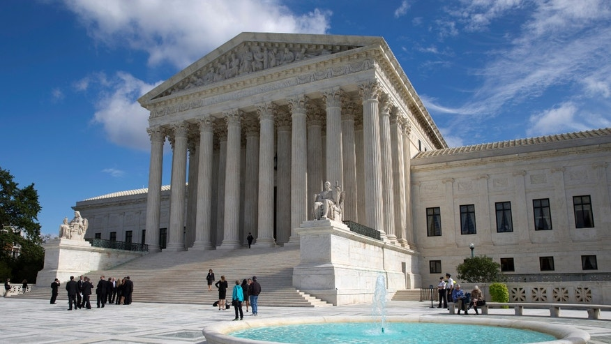 The Supreme Court is seen in Washington, Monday, Oct. 5, 2015. The Supreme Court is starting a new term that promises a steady stream of divisive social issues, and also brighter prospects for conservatives who suffered more losses than usual in recent months. (AP Photo/Carolyn Kaster)