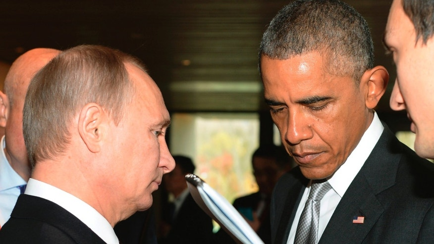 FILE -- Nov. 11, 2014: Russian President Vladimir Putin, left, and President Barack Obama, talk on the sidelines of the Asia-Pacific Economic Cooperation (APEC) Summit in Beijing. (AP)