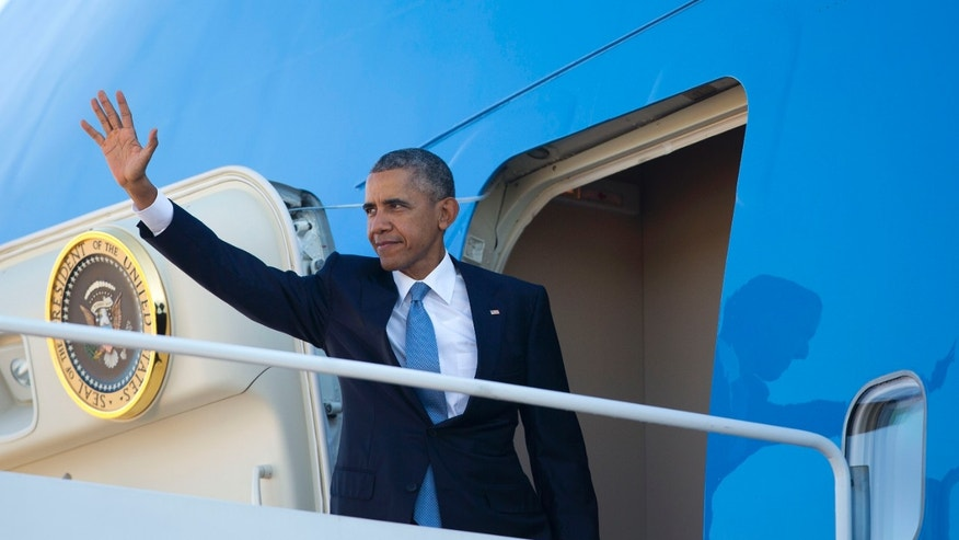 Friday, Oct. 9, 2015: President Obama waves as he boards Air Force One before his departure from Andrews Air Force Base, Md. Obama is traveling to Roseburg, Ore., to meet with families of the victims of the Oct. 1, shooting at Umpqua Community College, as part of a four-day West Coast tour.