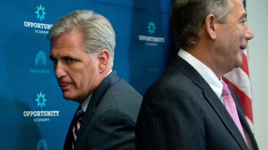 FILE -- Sept. 29, 2015: House Majority Leader Kevin McCarthy of Calif., left, squeezes behind outgoing House Speaker John Boehner of Ohio at the start of a news conference on Capitol Hill in Washington.  (AP Photo/Carolyn Kaster)