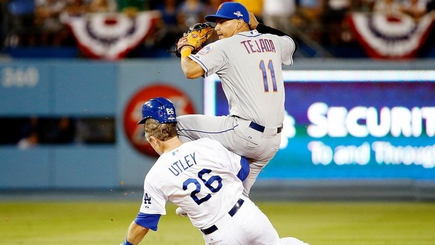 Ruben Tejada is hit by a slide by Chase Utley on October 10, 2015 in Los Angeles, California.