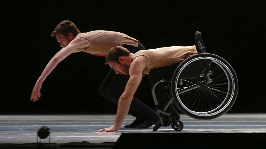 "Dancers from the United Kingdom's Candoco Dance Company perform a piece called ""Let's Talk About Dis"" at the Guanajuato State Auditorium during the 43rd edition of the Cervantino International Festival in Guanajuato, Mexico, Sunday, Oct. 11, 2015. The Candoco Dance Company mixes disabled and non-disabled dancers in many of its choreographies. (AP Photo/Mario Armas)"
