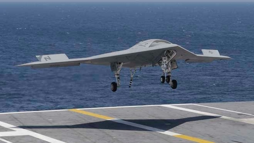 July 10, 2013: A X47-B Navy drone approaches the deck as it lands aboard the nuclear aircraft carrier USS George H. W. Bush off the Coast of Virginia.