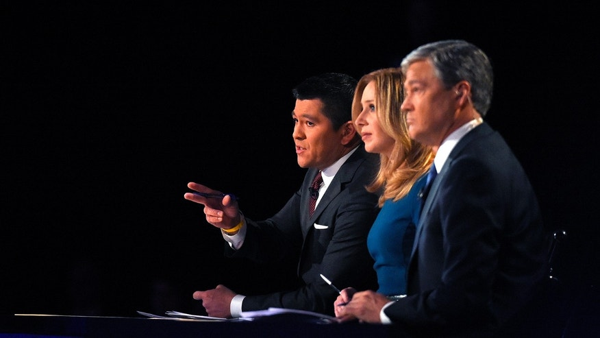 Debate moderators Carl Quintanilla, left, Becky Quick, center, and John Harwood appear during the CNBC Republican presidential debate at the University of Colorado, Wednesday, Oct. 28, 2015, in Boulder, Colo. (AP Photo/Mark J. Terrill)