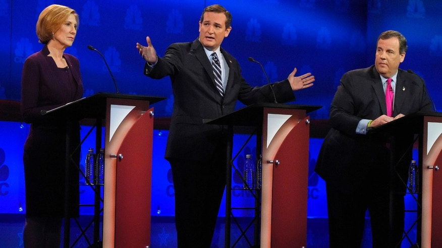 Ted Cruz, center, talks about the mainstream media as Carly Fiorina, left, and Chris Christie look on during the CNBC Republican presidential debate at the University of Colorado, Wednesday, Oct. 28, 2015, in Boulder, Colo. (AP Photo/Mark J. Terrill)