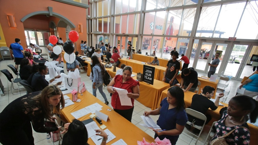 Oct. 6, 2015 -Job applicants fill out forms at a job fair in Miami. (AP)