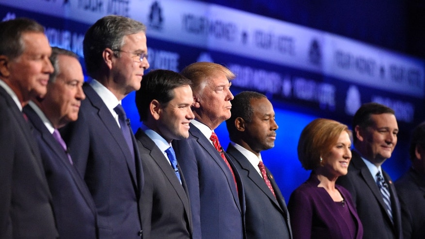 Oct. 28, 2015 - Republican presidential candidates, from left, John Kasich, Mike Huckabee, Jeb Bush, Marco Rubio, Donald Trump, Ben Carson, Carly Fiorina, and Ted Cruz take the stage during the CNBC Republican presidential debate at the University of Colorado, in Boulder, Colo. (AP)