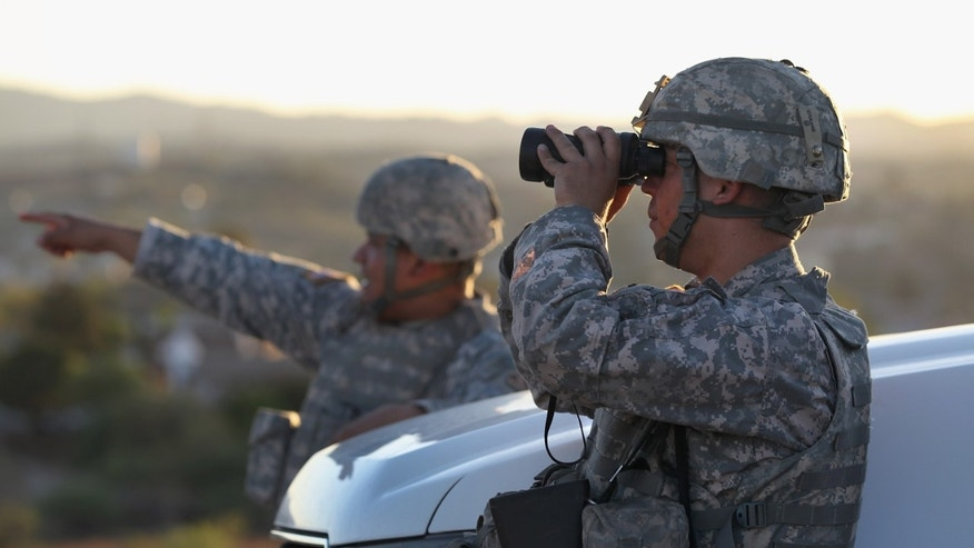 NOGALES, AZ - JUNE 22:  U.S. Army National Guardsmen scan the U.S.-Mexico border on June 22, 2011 in Nogales, Arizona. The Pentagon recently extended the deployment of some 1,200 guardsmen who were deployed last year to assist with border security on the U.S.-Mexico border until September 30. Soldiers at Early Identification Team (EIT) observation posts in Nogales work 24 hour shifts, each taking turns resting for 4 hours during the night. The National Guard troops are strictly on surveillance duty, although they are armed and have been credited with helping U.S. Border Patrol agents arrest up to 17,000 illegal immigrants crossing into the United States.  (Photo by John Moore/Getty Images)
