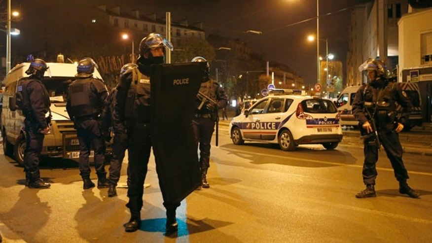 Nov. 18, 2015: Police forces prepare in Paris after reports of a shooting in the northern suburb of St. Denis.(AP Photo/Francois Mori)